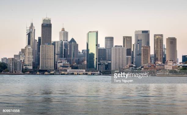 Sydney, Australia - April 15, 2017: Beautiful sunrise over Sydney CBD with many financial towers. Viewed from Wilson Point Wharf in Kirribilli, North Sydney.