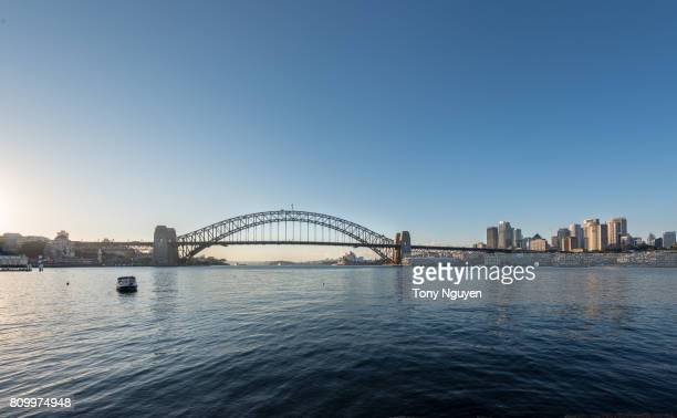 Beautiful sunrise over Sydney Harbour Bridge. Viewed from Blues Point Reserve in North Sydney.