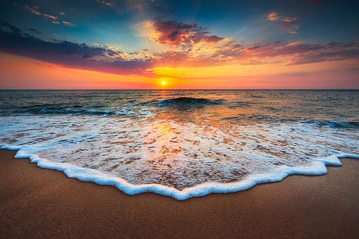 Beautiful sunrise over the sea 610041376