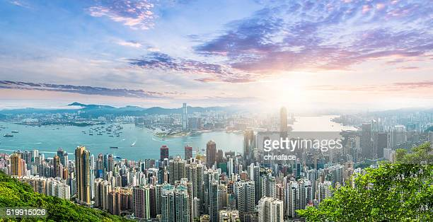 beautiful  sunrise over victoria harbor - kowloon peninsula stock pictures, royalty-free photos & images