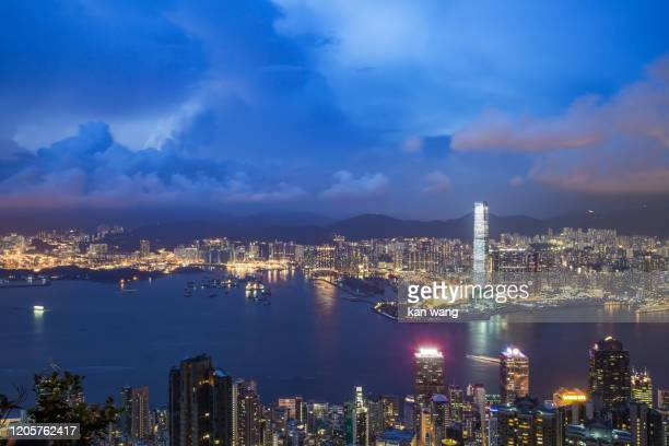 beautiful sunrise over victoria harbor - stock photo - kowloon peninsula stock pictures, royalty-free photos & images