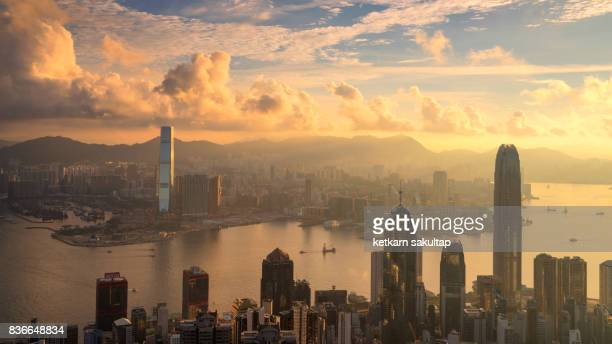 Beautiful sunrise over Victoria harbour, a view from Victoria peak at golden hour.