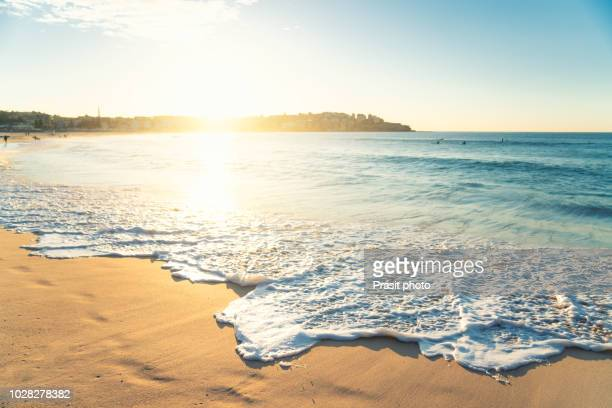 beautiful sunrise seascape in bondi beach at sydney, australia. - beach stock pictures, royalty-free photos & images