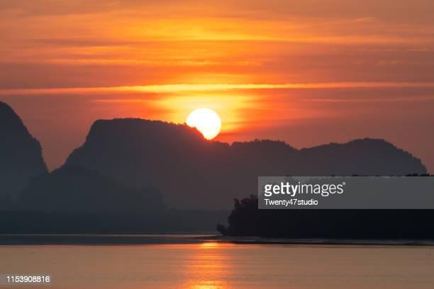 beautiful sunrise view of fisherman village in phang nga, thailand - インド洋 ストックフォトと画像