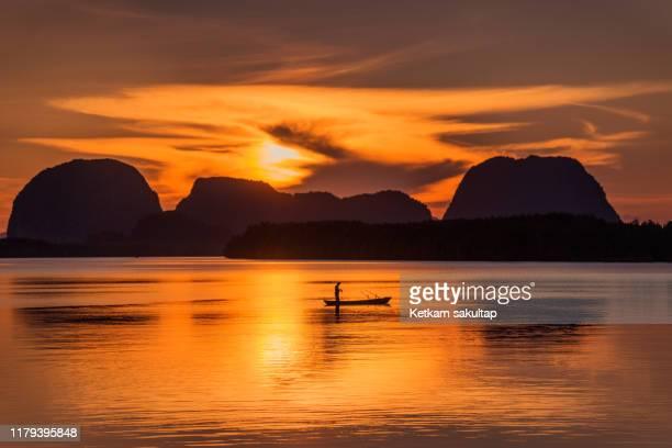 beautiful sunrise with at phang nga bay, thailand. - インド洋 ストックフォトと画像