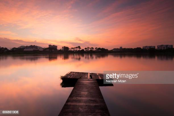 Beautiful sunrise with colors reflected from lake in a calm and serene morning.