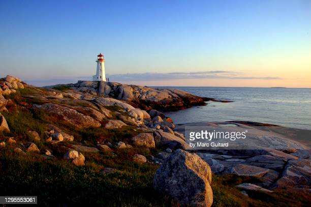 beautiful sunset along the atlantic ocean at peggy's cove, nova scotia, canada - famous place stock pictures, royalty-free photos & images