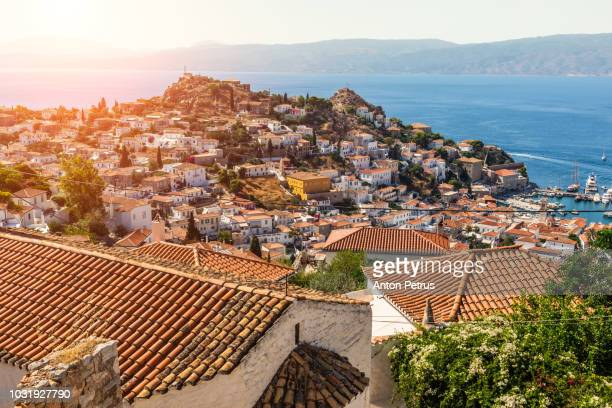 beautiful sunset at hydra island, greece - hydra greece stock photos and pictures