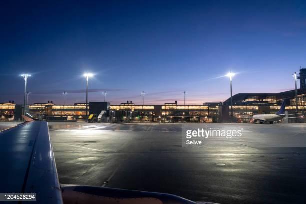 beautiful sunset at international airport runway - airport tarmac stock pictures, royalty-free photos & images