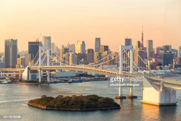 beautiful sunset at rainbow bridge and tokyo tower,tokyo,japan - ueno park stock photos and pictures
