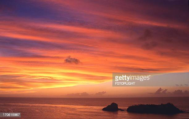 beautiful sunset at sea - fstoplight stock photos and pictures