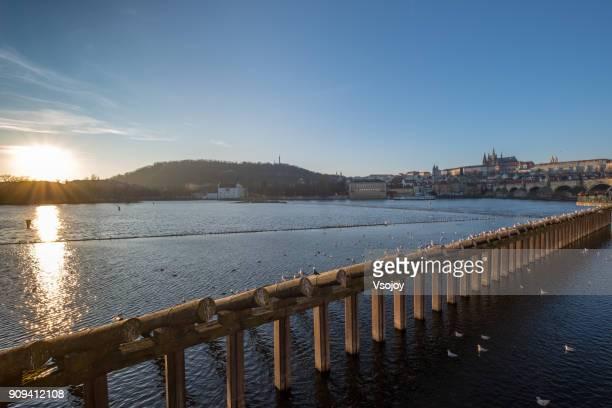 beautiful sunset at the vltava river, prague, czech republic - vsojoy stock pictures, royalty-free photos & images