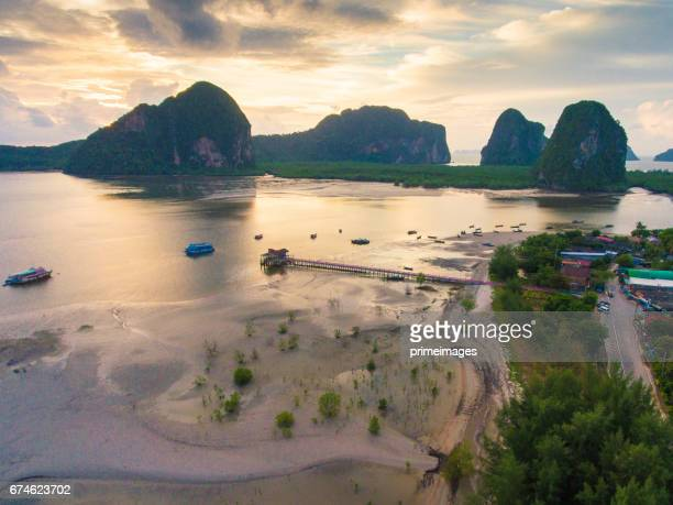 beautiful sunset at tropical sea with long tail boat in south thailand - primeimages stock pictures, royalty-free photos & images