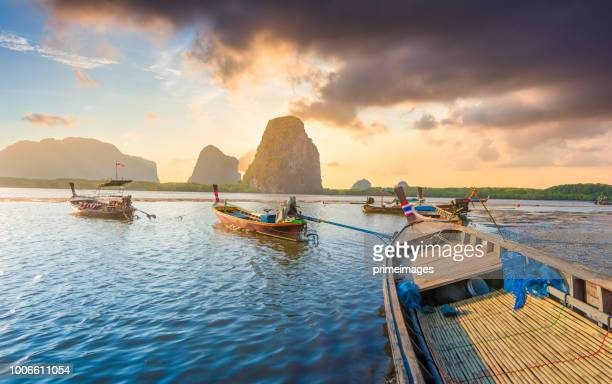 beautiful sunset at tropical sea with long tail boat trang province in south thailand - southeast stock pictures, royalty-free photos & images