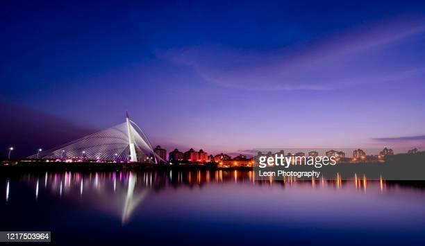 beautiful sunset at wawasan bridge - putrajaya stock pictures, royalty-free photos & images