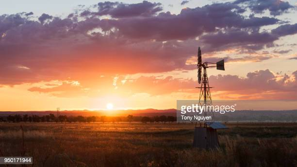 beautiful sunset beside windmill in rural area, one of the most popular scene in regions in australia. - horizontal stock pictures, royalty-free photos & images