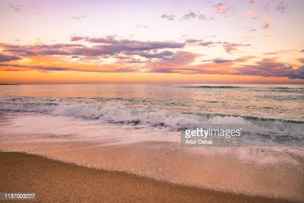 beautiful sunset by the sea with waves in the mediterranean. - 4k resolution stock pictures, royalty-free photos & images