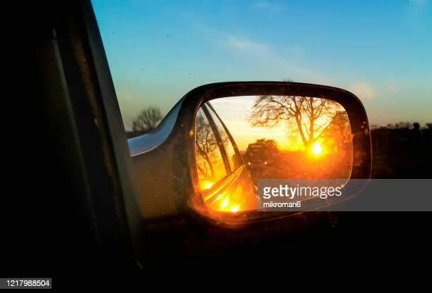 beautiful sunset from the driver's point while driving the car - moody sky stock pictures, royalty-free photos & images