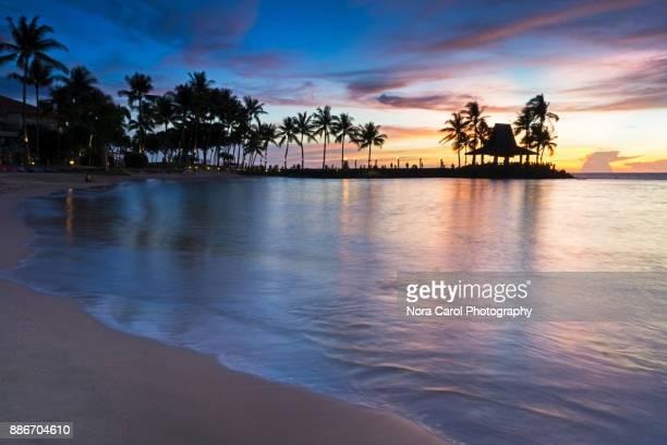 beautiful sunset in tanjung aru beach, kota kinabalu beach - island of borneo stock pictures, royalty-free photos & images