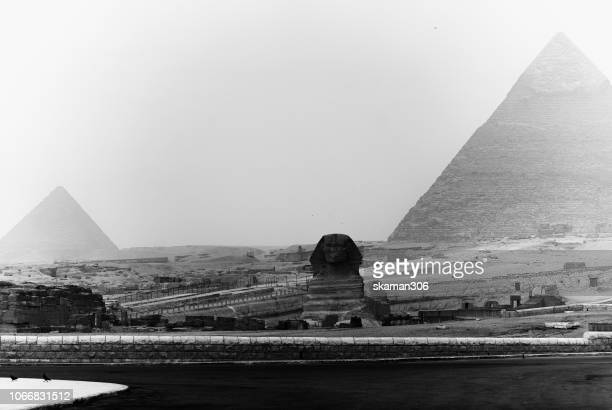 beautiful sunset landscape the pyramids of giza and sphinx - the sphinx stock pictures, royalty-free photos & images