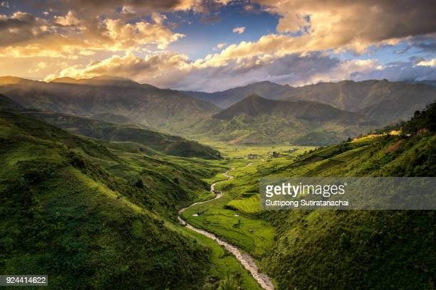Beautiful sunset landscape view of rice terraces and house in mountain valley , Tule Northern of Vietnam