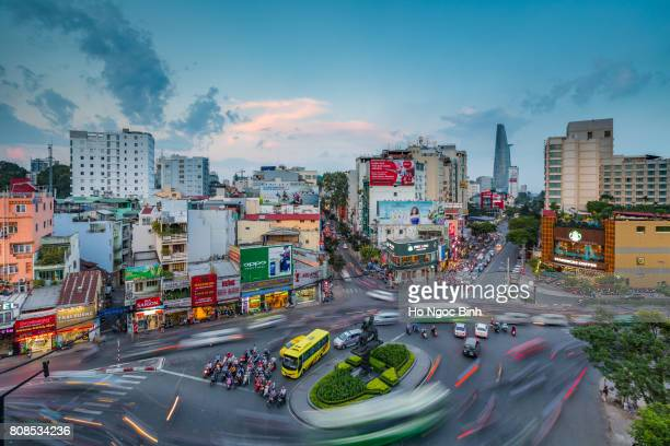 beautiful sunset over downtown saigon - the biggest city in vietnam - ho chi minh city stock pictures, royalty-free photos & images