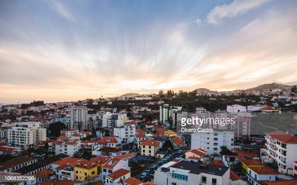beautiful sunset over funchal capital in madeira island. - funchal stock pictures, royalty-free photos & images
