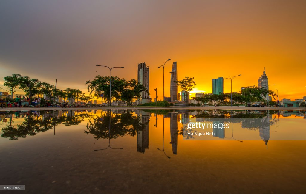 Beautiful Sunset over Saigon reflection - the biggest city in Vietnam : Stock Photo