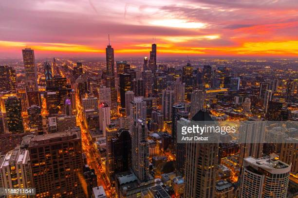 beautiful sunset over the chicago downtown with skyscrapers and horizon. - diminishing perspective stock pictures, royalty-free photos & images
