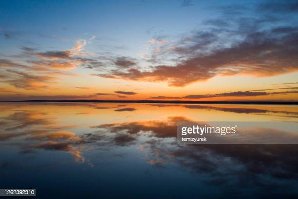 beautiful sunset over the lake - romantic sunset stock pictures, royalty-free photos & images