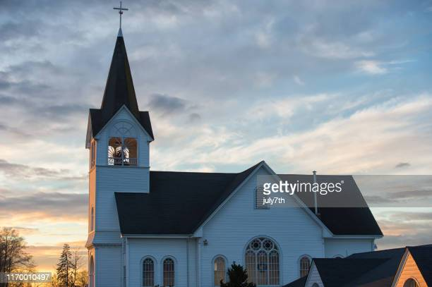 beautiful sunset over the lutheran church - protestantism stock pictures, royalty-free photos & images