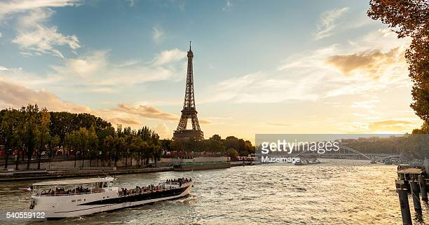 Beautiful sunset shows a barge along the Seine River in Paris.