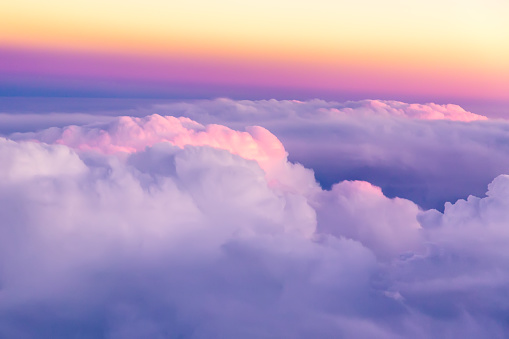 Beautiful sunset sky above clouds with nice dramatic light. View from airplane window 1045890176