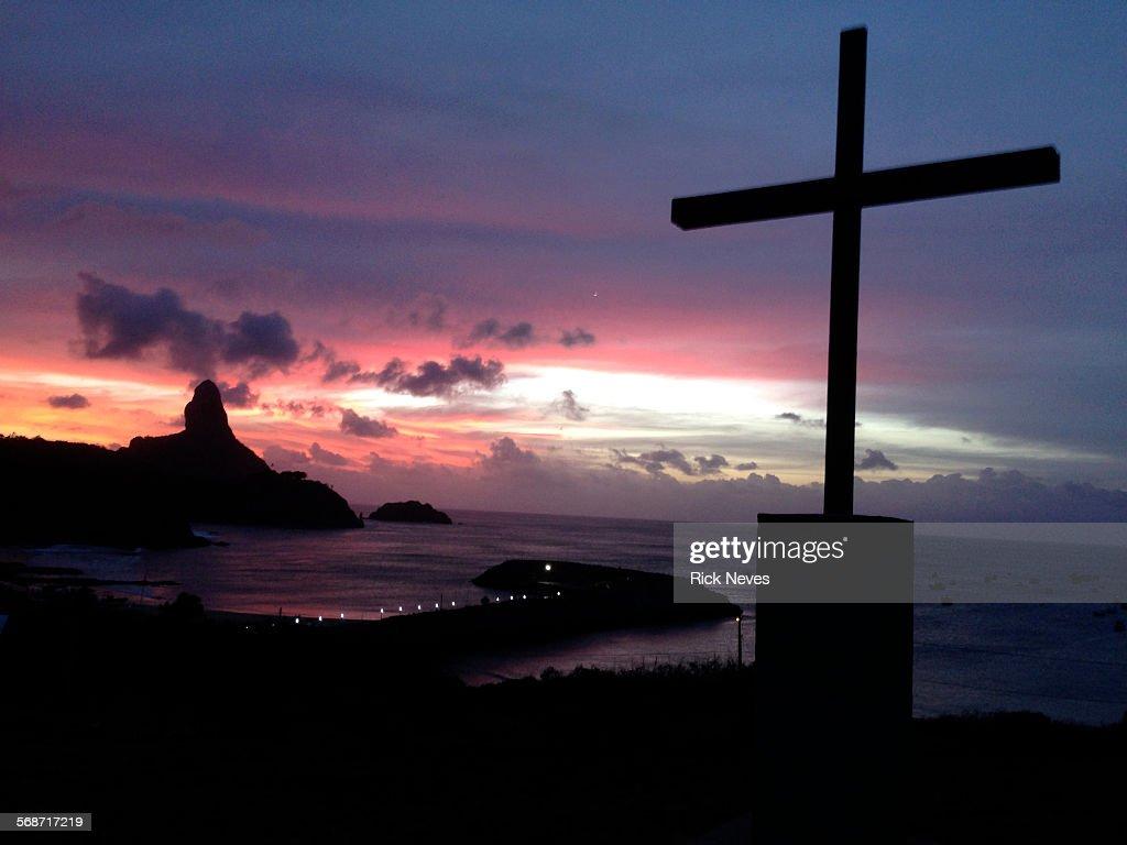 Beautiful sunset with cross in Fernando de Noronha : Stock Photo