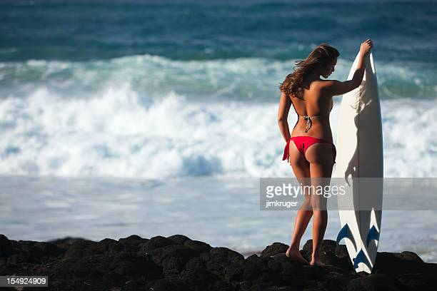 Beautiful surfer modeling with board in Hawaii.