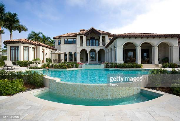 beautiful swimming pool at an estate home - naples florida stock pictures, royalty-free photos & images