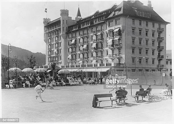 Beautiful Switzerland Continues to Attract Continental Tourists Photo shows a tennis tournament at Gstaad in the Bernese Oberland Switzerland