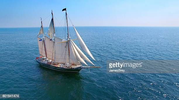 beautiful tall ship sailing calm waters in good weather - pirate ship stock photos and pictures
