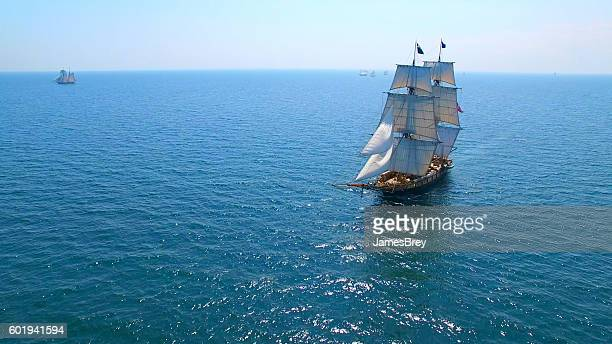 beautiful tall ship sailing deep blue waters toward adventure - pirate ship stock photos and pictures