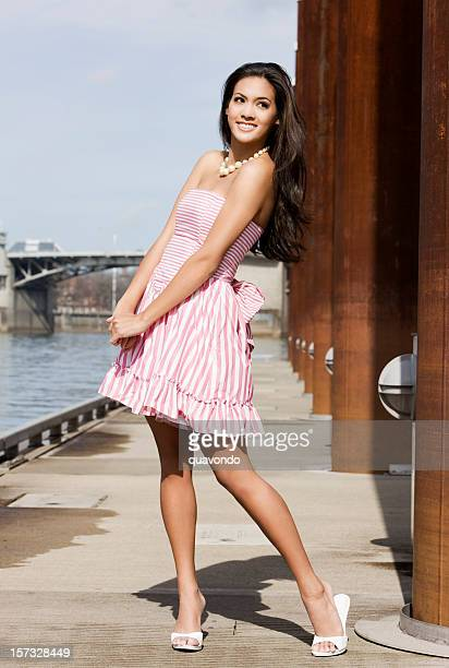 beautiful tan young woman in pink striped dress on pier - beautiful long legs stock pictures, royalty-free photos & images