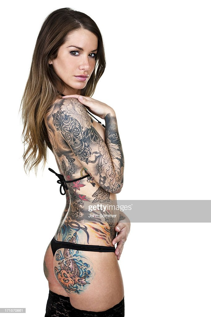 Beautiful tattooed woman isolated on white background : Stock Photo