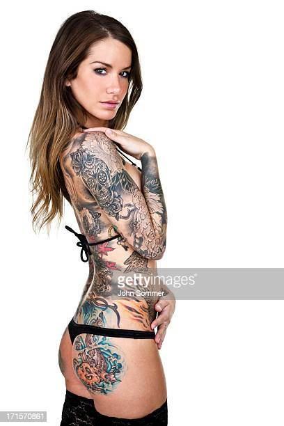 beautiful tattooed woman isolated on white background - beautiful female bottoms stock pictures, royalty-free photos & images