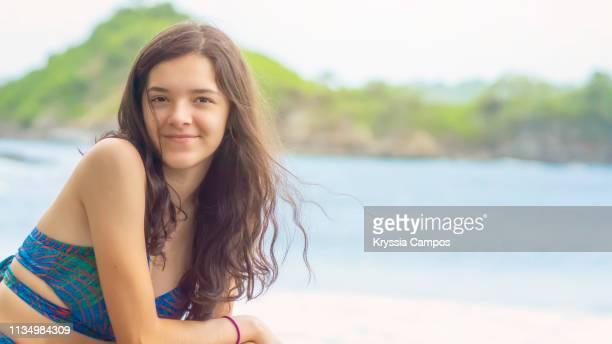 Beautiful teenage girl enjoys the beach in Costa Rica