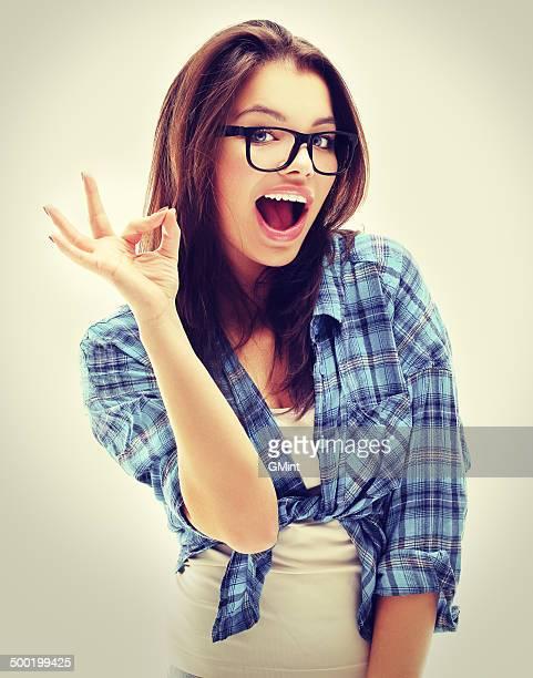 Beautiful teenage girl ok gesture