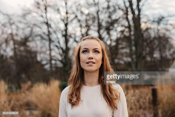Beautiful teenage girl outdoors in nature