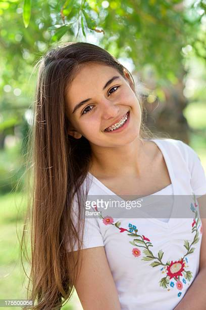 beautiful teenage girl with braces - beautiful girl smile braces vertical stock photos and pictures