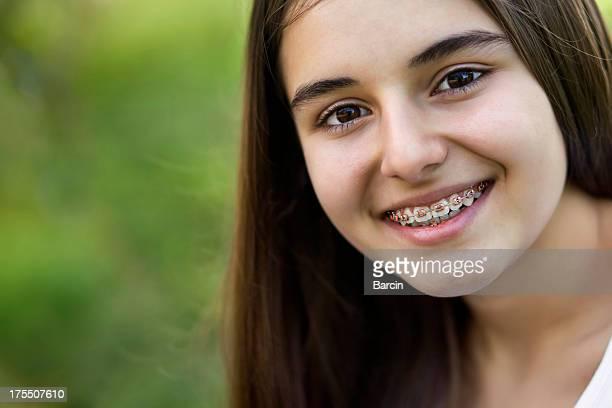 Beautiful teenage girl with braces