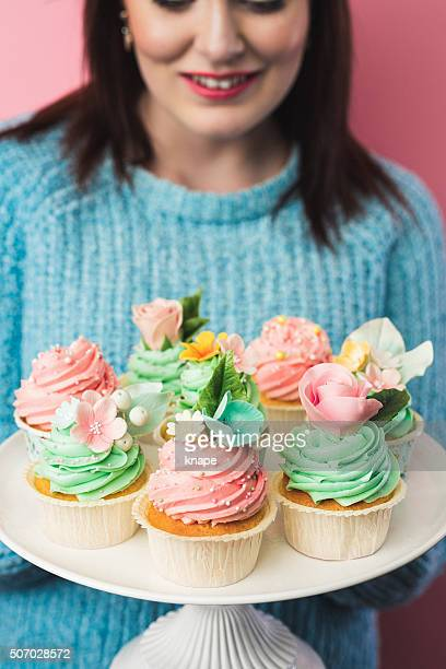Beautiful teenage girl with cute cupcakes