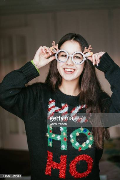 beautiful teenager in xmas sweater and   funny glasses - very ugly women stock pictures, royalty-free photos & images