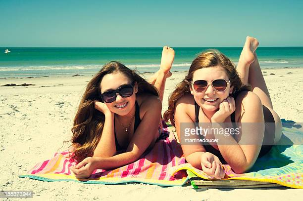 Beautiful teenagers sunbathing on the beach.